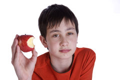 Boy eating a red apple Stock Photo