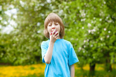 Boy Eating Red Apple Stock Image