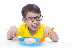 Boy eating rice. Royalty Free Stock Image
