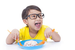 Boy eating rice. Royalty Free Stock Photography