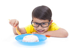 Boy eating rice. Stock Photos