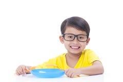 Boy eating rice. Stock Image