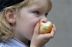 Boy eating a roll Stock Photos
