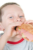Boy eating sandwich Royalty Free Stock Images