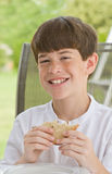 Boy Eating a Sandwich Royalty Free Stock Images