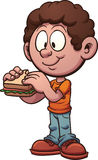 Boy eating a sandwich Stock Images