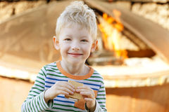 Boy eating smores Stock Photo