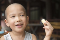 Boy eating snack Royalty Free Stock Photos