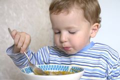 Boy eating soup Stock Photos
