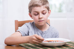 Boy eating soup Royalty Free Stock Photos