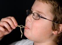 Boy Eating Spaghetti Stock Photos