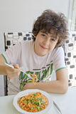The Boy is Eating Spaghetti Stock Photo