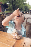 Boy eating spring rolls Royalty Free Stock Images