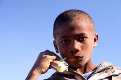 Boy eating sugar cane Royalty Free Stock Image