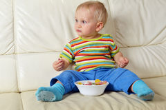 Boy eating sweets Royalty Free Stock Photos