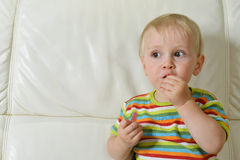 Boy eating sweets Royalty Free Stock Photo