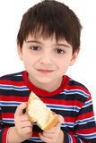Boy Eating Toast Royalty Free Stock Images