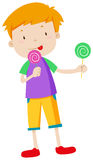 Boy eating two lolipops Stock Photos