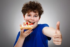 Boy eating waffle Royalty Free Stock Photos