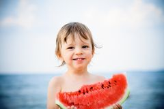 Boy eating watermelon Stock Photos