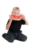 Boy eating a watermelon Stock Photos