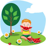 Boy eating a watermelon Royalty Free Stock Photos
