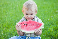 Boy eating watermelon Stock Photography
