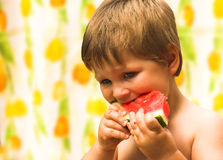 Boy eating a watermelon Stock Photo