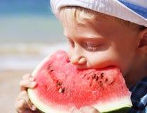 Boy eating watermelon Stock Photos