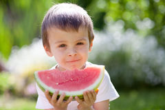 Boy, eating watermelon in the garden Royalty Free Stock Image