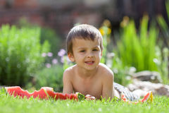 Boy, eating watermelon in the garden Royalty Free Stock Photography