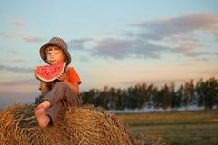 Boy eating watermelon Stock Photo
