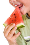 Boy eating watermelon slice Stock Photos