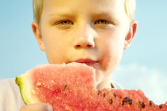 Boy eating watermelon slice Royalty Free Stock Images