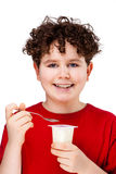Boy eating yogurt Stock Photo