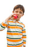 Boy eats an apple good for health Royalty Free Stock Photography