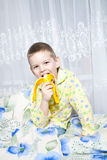 Boy eats a banana. How do we bring bananas? Very tasty bananas Royalty Free Stock Photo