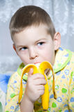 Boy eats a banana. How do we bring bananas? Very tasty bananas Stock Images