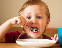 Boy eats breakfast Stock Photos