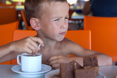 Boy eats in a cafe. Stock Image