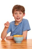 Boy eats cereals Royalty Free Stock Photography
