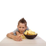 Boy eats chips Royalty Free Stock Images