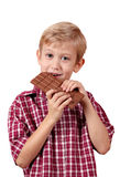 Boy eats chocolate Royalty Free Stock Photography