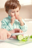 Boy eats cucumber Royalty Free Stock Photo