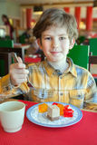Boy eats dessert Stock Photo