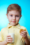 Boy eats homemade pie Royalty Free Stock Images