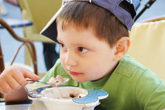 Boy eats ice-cream Stock Photo