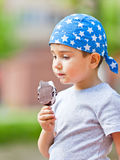 Boy eats ice cream Royalty Free Stock Images