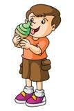 Boy eats ice cream Royalty Free Stock Image