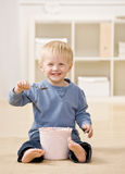 Boy eats ice cream from tub Royalty Free Stock Photos